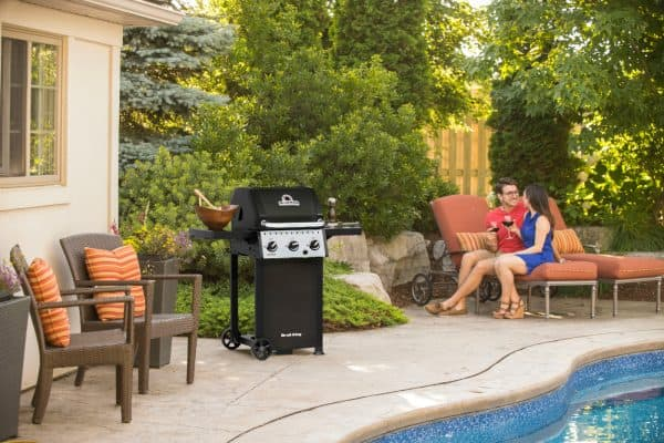 Crown Classic bbq 310 at poolside with a couple